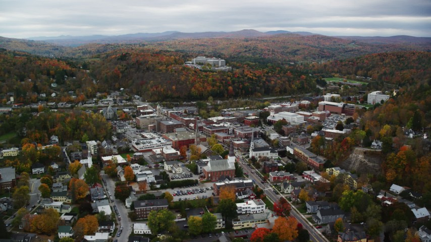 6K stock footage aerial video flying by downtown buildings, colorful foliage, overcast, autumn, Montpelier, Vermont Aerial Stock Footage | AX150_359