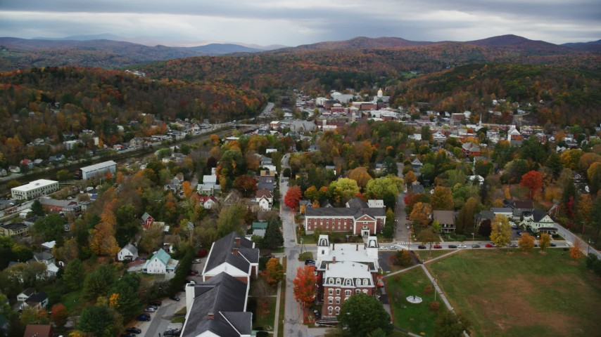 6K stock footage aerial video flying by Vermont College of Fine Arts, homes, autumn, Montpelier, Vermont Aerial Stock Footage | AX150_361