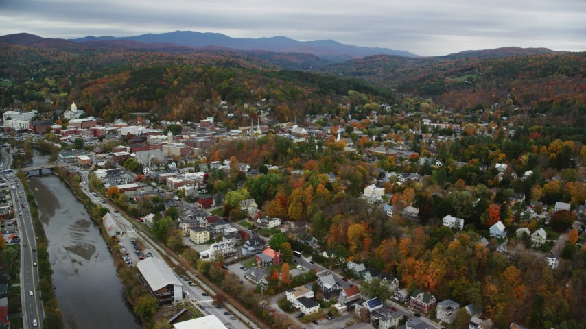6K stock footage aerial video flying by downtown in autumn, Winooski River, overcast sky, Montpelier, Vermont Aerial Stock Footage | AX150_362
