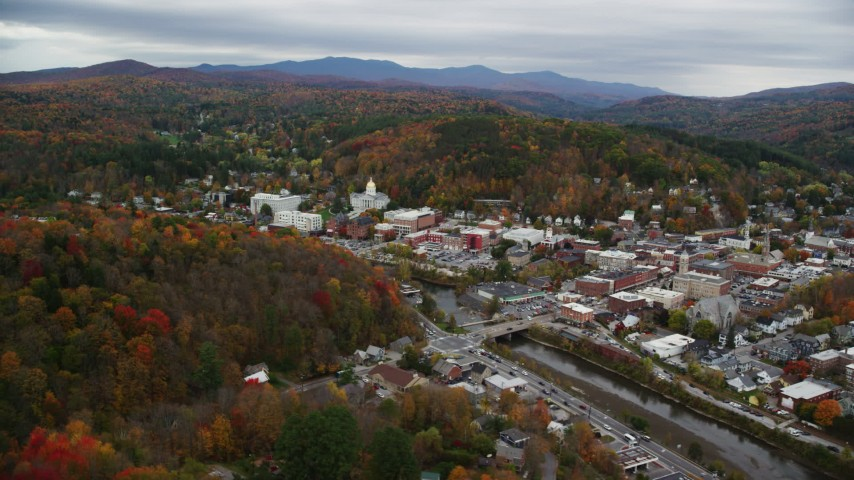 6K stock footage aerial video flying by downtown, Vermont State House from across a river, Montpelier, Vermont Aerial Stock Footage | AX150_363