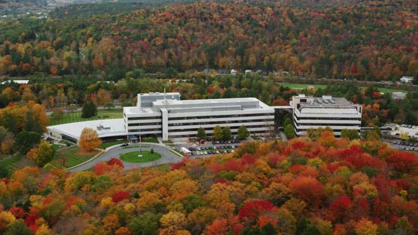 6K stock footage aerial video orbiting office buildings and colorful trees in autumn, Montpelier, Vermont Aerial Stock Footage | AX150_367