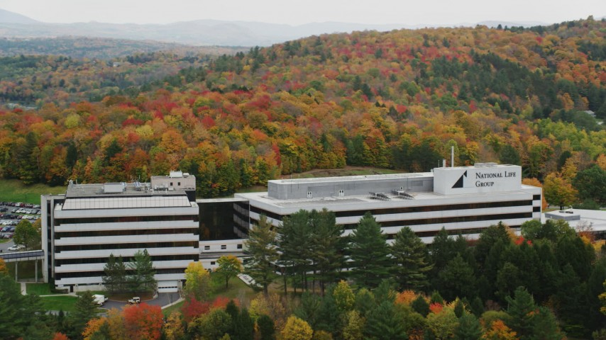 6K stock footage aerial video orbiting office buildings surrounded by brightly colored trees, autumn, Montpelier, Vermont Aerial Stock Footage | AX150_371