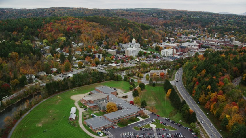 6K stock footage aerial video flying by Montpelier High School, downtown, Vermont State House, autumn, Montpelier, Vermont Aerial Stock Footage | AX150_372