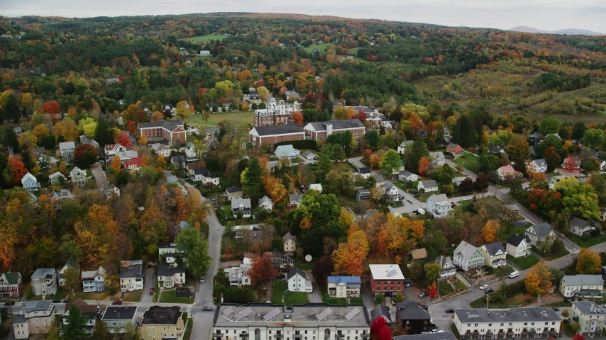 6K stock footage aerial video flying by neighborhood, Vermont College of Fine Arts, autumn, Montpelier, Vermont Aerial Stock Footage | AX150_375