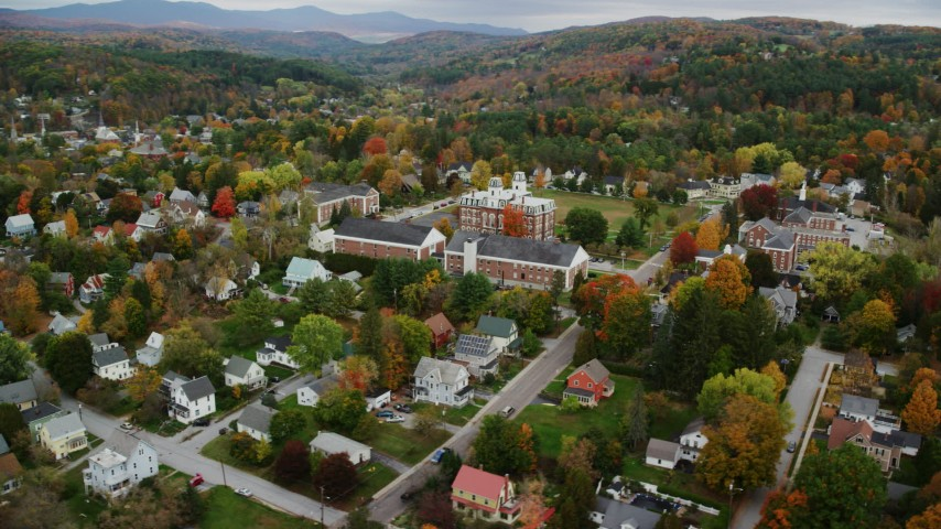 6K stock footage aerial video orbiting Vermont College of Fine Arts, neighborhood, autumn, Montpelier, Vermont Aerial Stock Footage | AX150_376