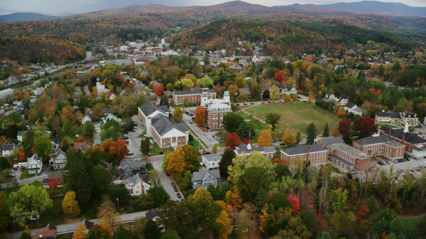 6K stock footage aerial video orbiting Vermont College of Fine Arts, colorful trees, autumn, Montpelier, Vermont Aerial Stock Footage AX150_377 | Axiom Images