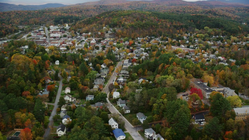 6K stock footage aerial video flying by residential neighborhoods, colorful trees, autumn, Montpelier, Vermont Aerial Stock Footage | AX150_378