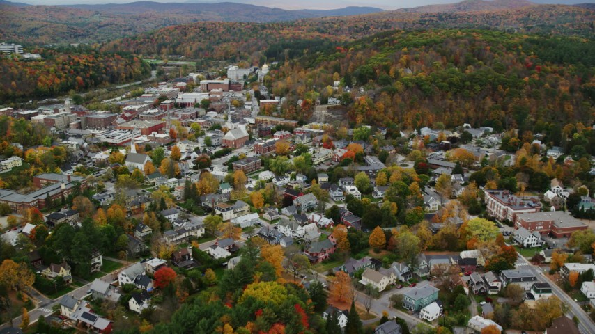 6K stock footage aerial video flying by downtown, surrounding neighborhoods, autumn, Montpelier, Vermont Aerial Stock Footage | AX150_379