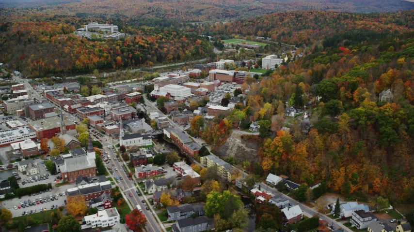 6K stock footage aerial video flying by downtown buildings, panning right to colorful trees, Montpelier, Vermont Aerial Stock Footage | AX150_380