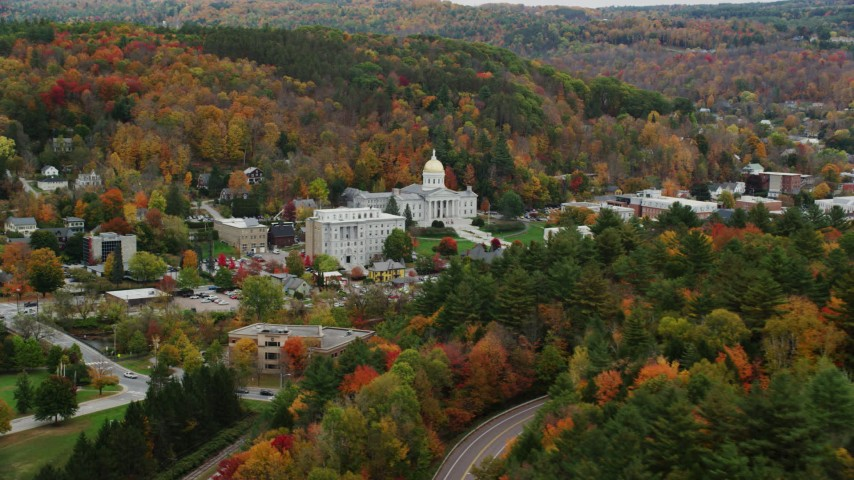 6K stock footage aerial video flying away from Vermont State House, by colorful trees, autumn, Montpelier, Vermont Aerial Stock Footage | AX150_384