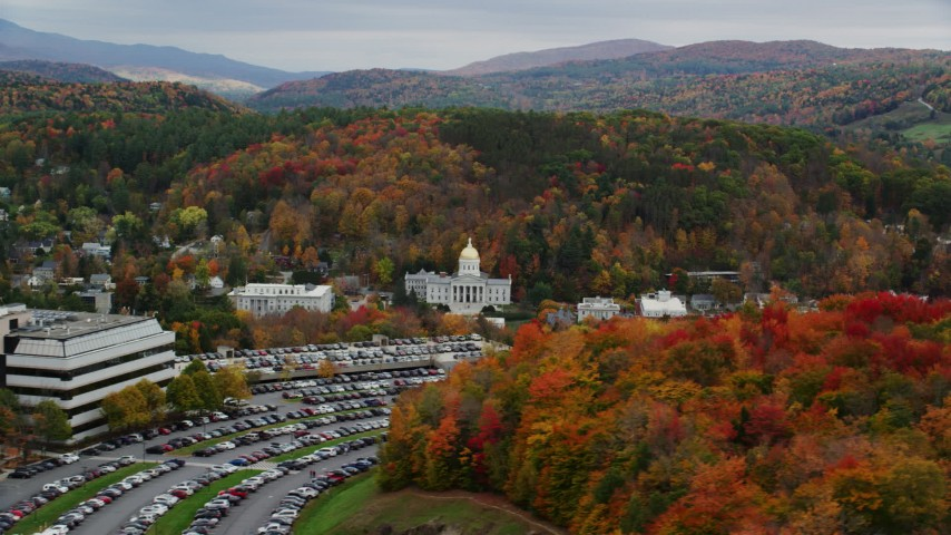 6K stock footage aerial video flying by office building, Vermont State House, autumn, Vermont State House Aerial Stock Footage | AX150_386
