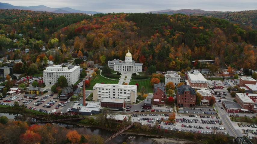 6K stock footage aerial video approaching Vermont State House, downtown, colorful trees in autumn, Montpelier, Vermont Aerial Stock Footage | AX150_388