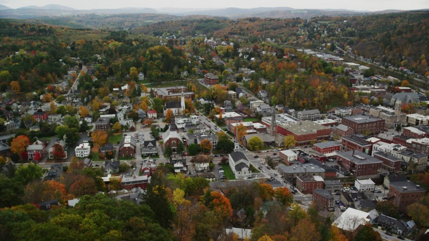6K stock footage aerial video approaching downtown churches and tilt down, autumn, Montpelier, Vermont Aerial Stock Footage | AX150_390