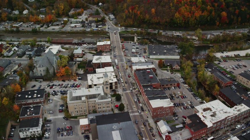 6K stock footage aerial video tilting down, fly by St. Augustine's Catholic Church, Montpelier City Hall, autumn, Montpelier, Vermont Aerial Stock Footage | AX150_391