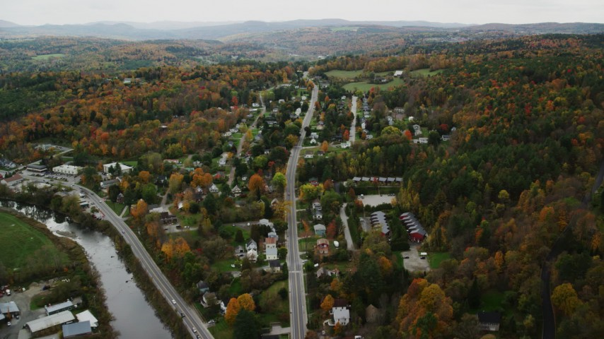 6K stock footage aerial video flying by neighborhood near river, colorful trees in autumn, Montpelier, Vermont Aerial Stock Footage | AX150_392