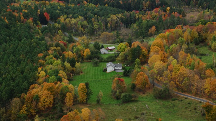6K stock footage aerial video flying over rural homes, colorful trees, tilt down, autumn, Montpelier, Vermont Aerial Stock Footage | AX150_394