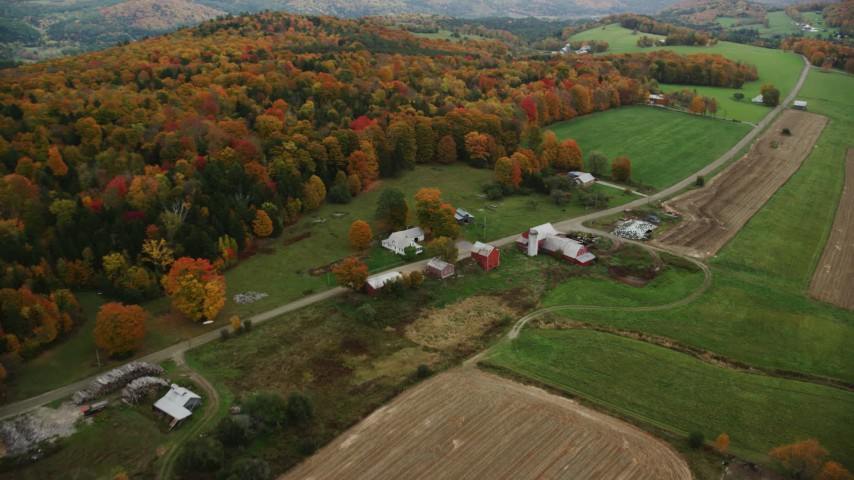 6K stock footage aerial video flying by Boudro Road, rural farms, foliage in autumn, Randolph Center, Vermont Aerial Stock Footage | AX150_409