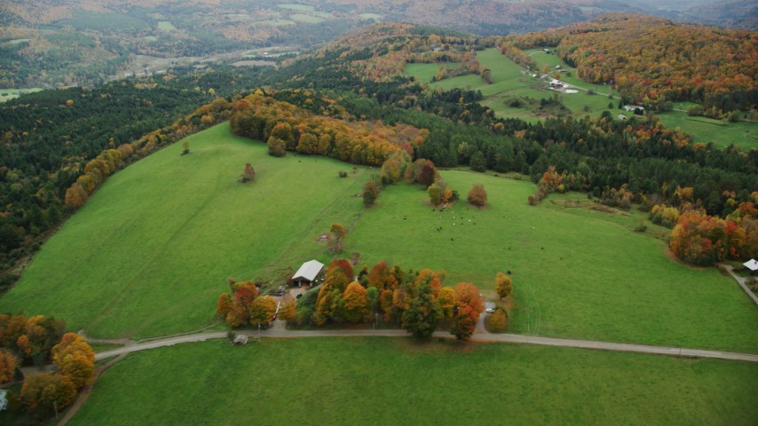 6K stock footage aerial video flying by farms, Silloway Road, grassy clearings, foliage, autumn, Randolph Center, Vermont Aerial Stock Footage | AX150_411