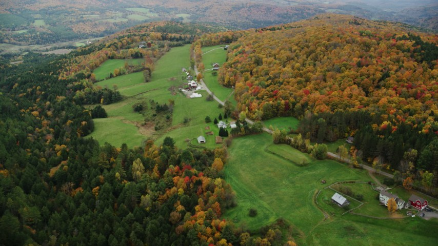 6K stock footage aerial video flying by farms, Davis Road, colorful trees, autumn, Randolph Center, Vermont Aerial Stock Footage | AX150_412
