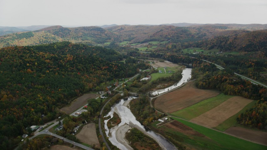 6K stock footage aerial video flying over small farms, White River, Route 14 in autumn, South Royalton, Vermont Aerial Stock Footage | AX150_424