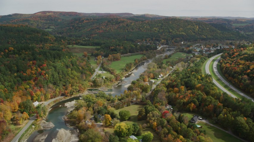 6K stock footage aerial video flying over White River, small farms, approach small rural town, autumn, South Royalton, Vermont Aerial Stock Footage | AX150_427