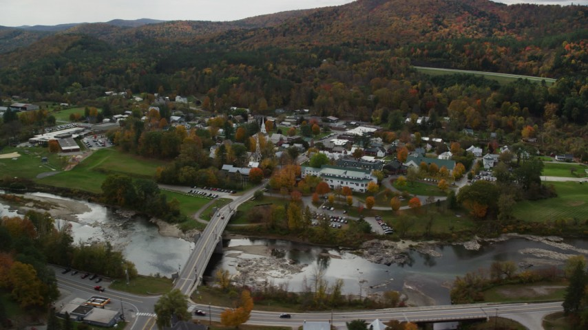 6K stock footage aerial video orbiting small bridge, White River, small rural town, autumn, South Royalton, Vermont Aerial Stock Footage AX150_429 | Axiom Images