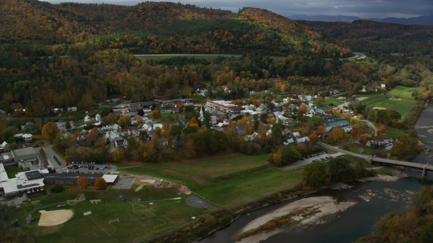 6K stock footage aerial video orbiting small rural town, White River, small bridge, autumn, South Royalton, Vermont Aerial Stock Footage | AX150_430