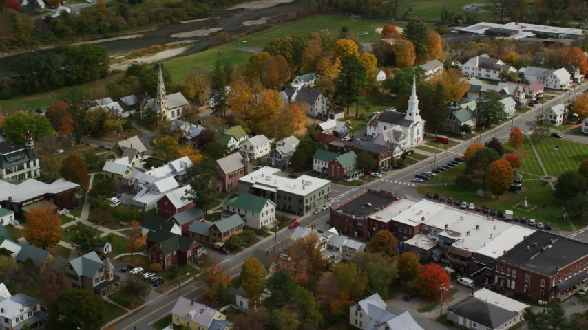 6K stock footage aerial video orbiting homes, churches in a small town, autumn, South Royalton, Vermont Aerial Stock Footage | AX150_433