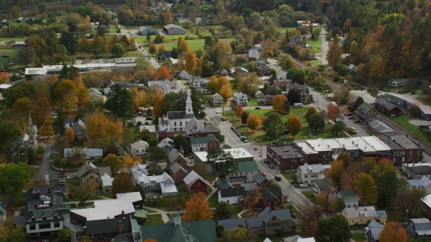 6K stock footage aerial video orbiting homes, churches and town square in small rural town, autumn, South Royalton, Vermont Aerial Stock Footage | AX150_434