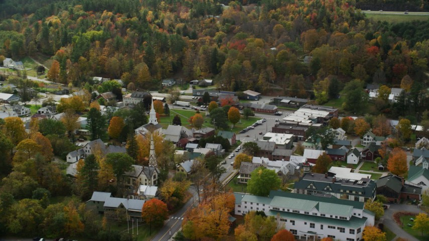 6K stock footage aerial video orbiting small rural town, colorful foliage in autumn, South Royalton, Vermont Aerial Stock Footage | AX150_435