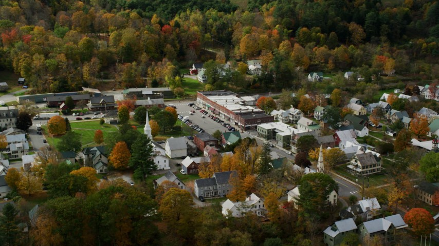 6K stock footage aerial video orbiting a small rural town and town square with colorful autumn trees, South Royalton, Vermont Aerial Stock Footage | AX150_436