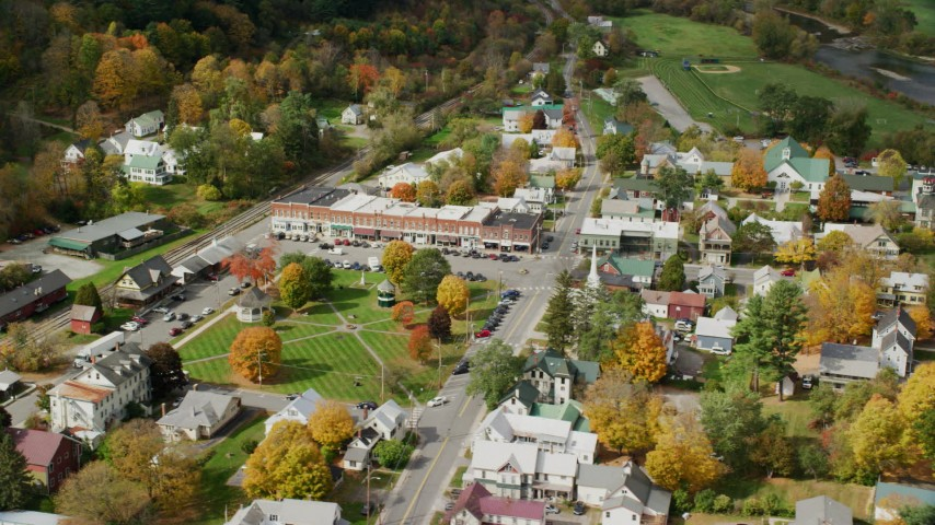 6K stock footage aerial video orbiting town square, row of shops, colorful foliage in small town, autumn, South Royalton, Vermont Aerial Stock Footage | AX150_437