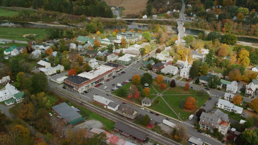 6K stock footage aerial video orbiting small rural town, town square, churches, shops, autumn, South Royalton, Vermont Aerial Stock Footage | AX150_438