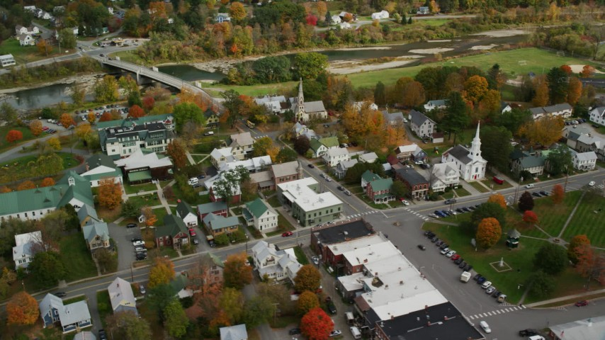 Orbit town square, churches, small rural town in autumn, South Royalton, Vermont Aerial Stock Footage | AX150_439