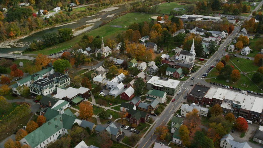 6K stock footage aerial video orbiting town square, churches, small rural town in autumn, South Royalton, Vermont Aerial Stock Footage | AX150_439