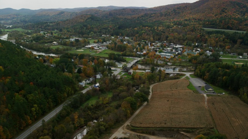 Approach White River, small bridge, small rural town in autumn, South Royalton, Vermont Aerial Stock Footage | AX150_440