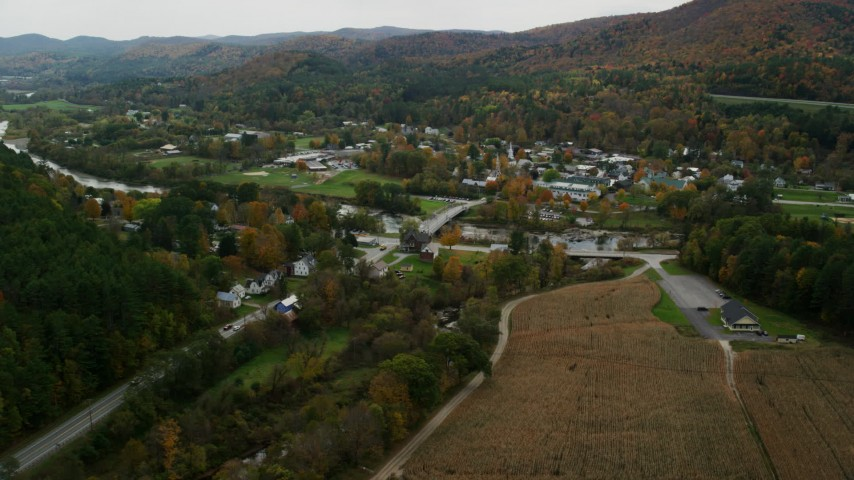 6K stock footage aerial video approaching White River, small bridge, small rural town in autumn, South Royalton, Vermont Aerial Stock Footage | AX150_440