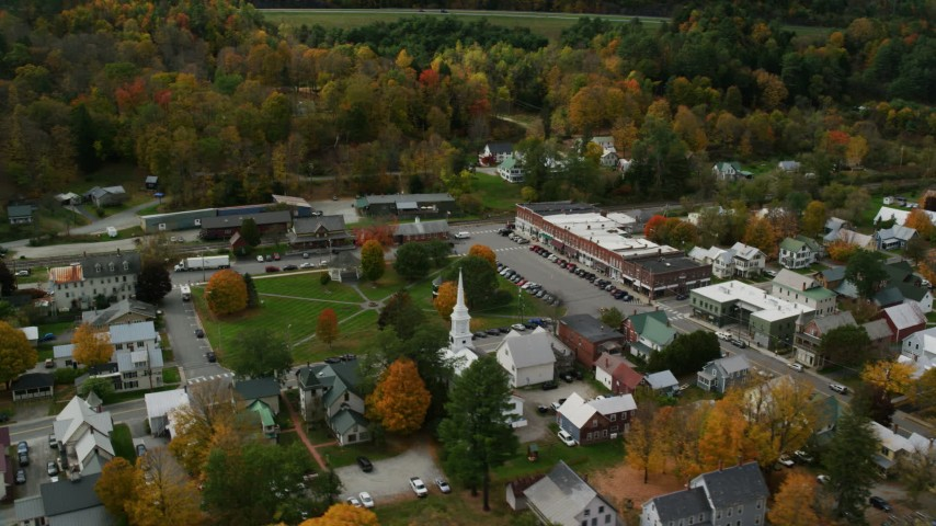 6K stock footage aerial video orbiting colorful foliage throughout small rural town adjacent to the town square, autumn, South Royalton, Vermont Aerial Stock Footage | AX150_442