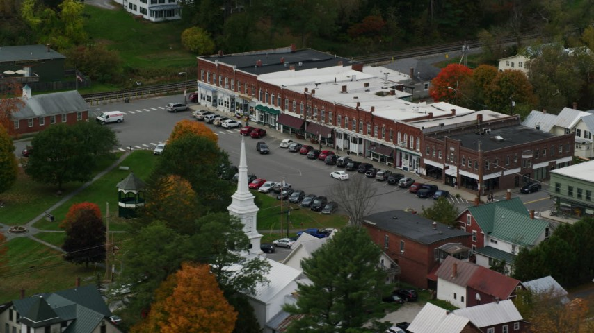 6K stock footage aerial video orbiting a row of shops near town square, small rural town, autumn, South Royalton, Vermont Aerial Stock Footage | AX150_447