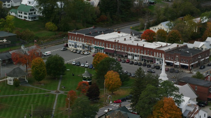 Orbit row of shops near town square, small rural town, autumn, South Royalton, Vermont Aerial Stock Footage | AX150_447