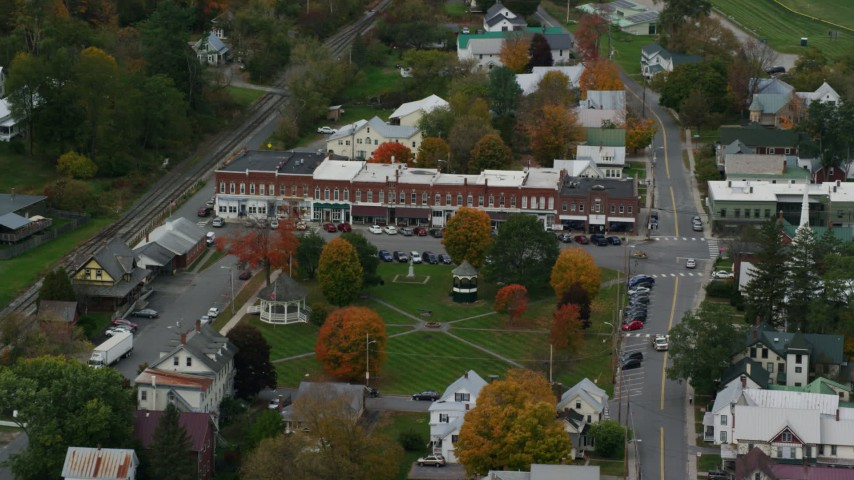 6K stock footage aerial video flying away from shops and town square in small rural town, autumn, South Royalton, Vermont Aerial Stock Footage AX150_448 | Axiom Images