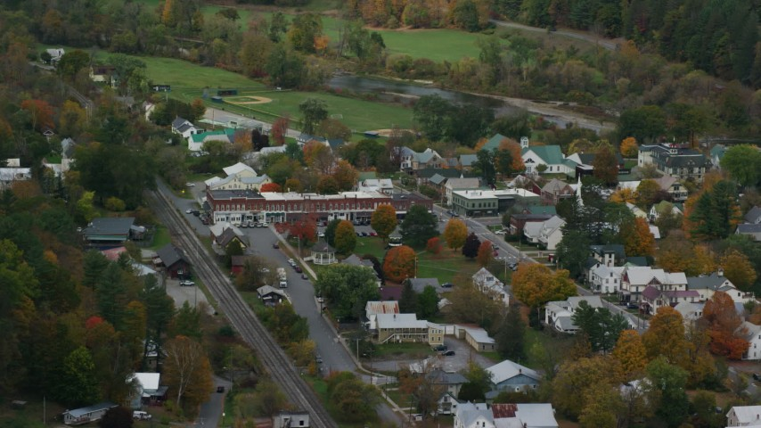 6K stock footage aerial video flying away from small rural town, shops, town square, autumn, South Royalton, Vermont Aerial Stock Footage | AX150_449