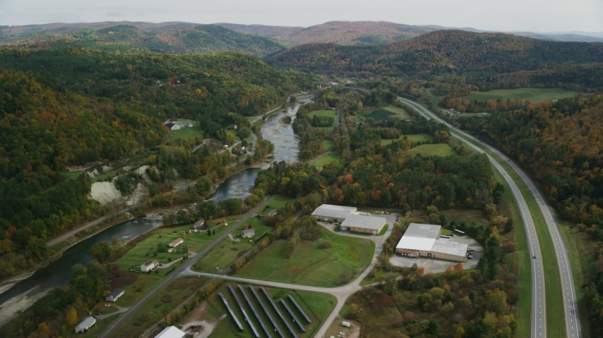 Fly over country roads, approach White River, autumn, South Royalton, Vermont Aerial Stock Footage | AX150_450