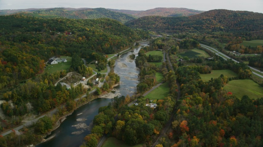 6K stock footage aerial video flying over country roads, approach White River, autumn, South Royalton, Vermont Aerial Stock Footage | AX150_450