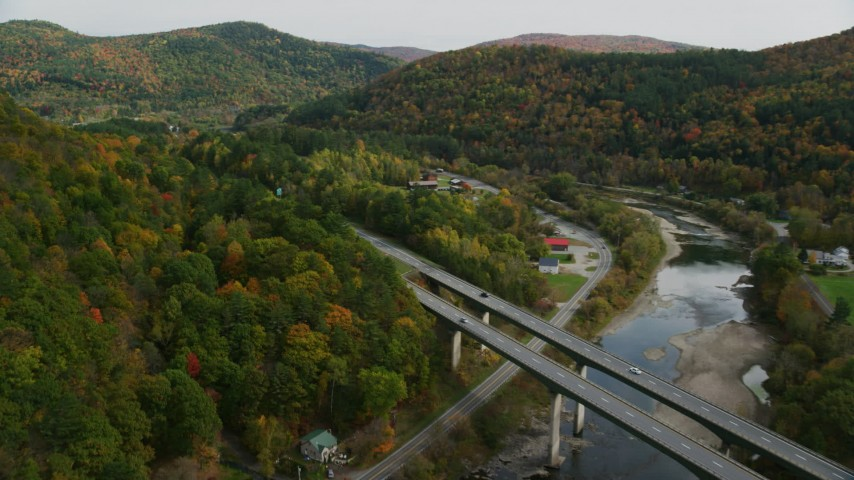 6K stock footage aerial video flying over White River, approach Interstate 89, small bridge, pan left, autumn, South Royalton, Vermont Aerial Stock Footage | AX150_452