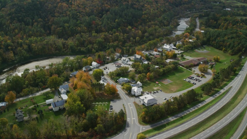 6K stock footage aerial video orbiting a small rural town near the White River, autumn, Sharon, Vermont Aerial Stock Footage | AX150_456