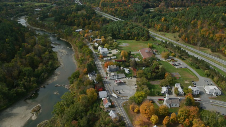 6K stock footage aerial video orbiting a small rural town on the White River, autumn, Sharon, Vermont Aerial Stock Footage | AX150_457