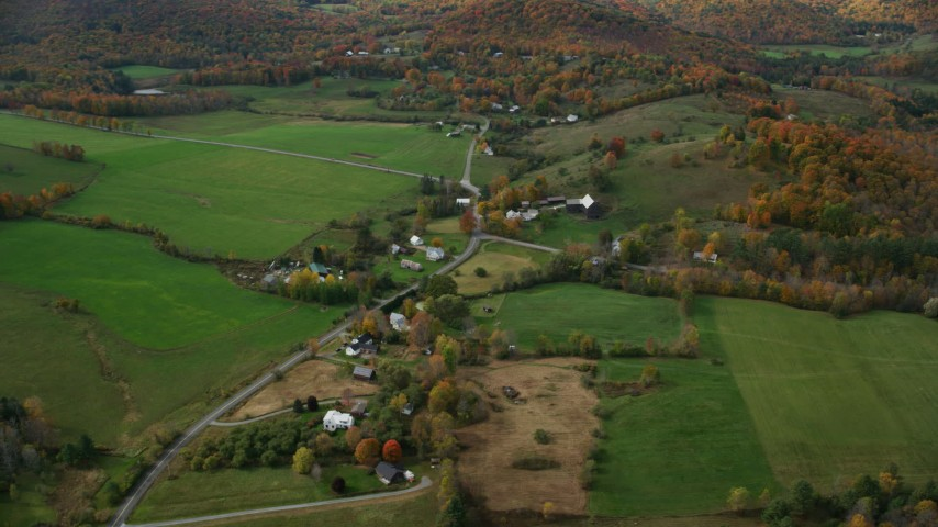 6K stock footage aerial video flying by farms, grassy clearings, Stage Road, autumn, North Pomfret, Vermont Aerial Stock Footage | AX150_459