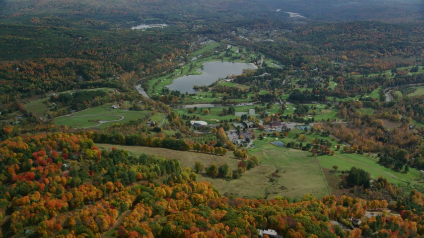 6K stock footage aerial video approaching Lakeland Golf Course, Lake Pinneo, autumn, Quechee, Vermont Aerial Stock Footage | AX150_466