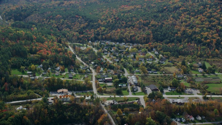 6K stock footage aerial video flying by small rural town, colorful trees, autumn, cloudy, Quechee, Vermont Aerial Stock Footage | AX150_469